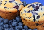6740500-two-fresh-baked-blueberry-muffins-surrounded-with-fresh-blueberries--extreme-close-up